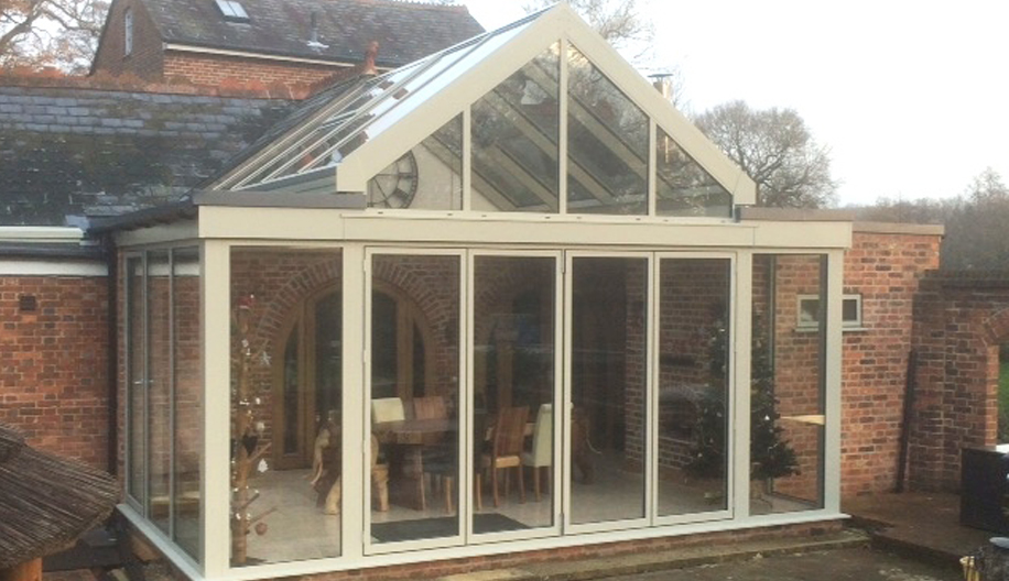 Conservatory extension to converted stable block in an Area of Outstanding Natural Beauty – Four Elms